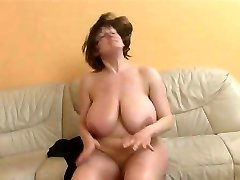 Mature lady with really gigantic orbs getting fucked