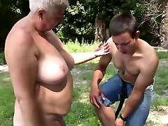 Bare Bold Nudist Grandmother and Young Cock Devotee