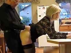 Mature couple humping in the kitchen