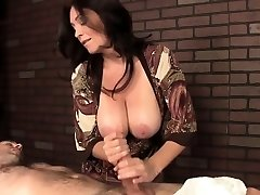 Fashionable mature masseuse with monster mounds tugs