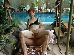 Mature redhead in bathing suit
