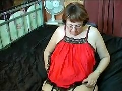 Grannie in Glasses and Stockings with a Dildo