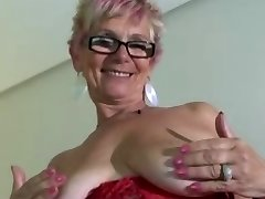 Granny in Glasses and Red Undergarments and Stockings Spreads