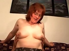 Hairy Mature Red-haired in Glasses and Stockings Drills