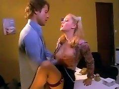 Pretty blonde secretary in stocking pummeled on the desk