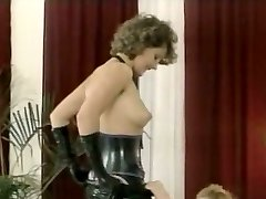 Hussy domme in latex attire gives deepthroat blowjob