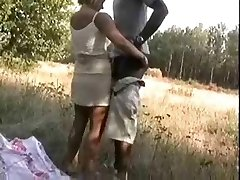 Blonde Wife pummeling a african on woods