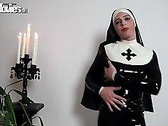 Bitchy latex nun rubbing her wild latex costume