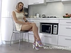 Kristinka strips in the kitchen and plays naked