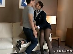 Hot stewardess is an Asian woman in high heels