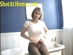 Blonde mom is posing and petting her pussy on homemade vid