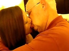 Super-hot Woman kissing a 82 yr old man