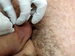 Piercing of the nutsack