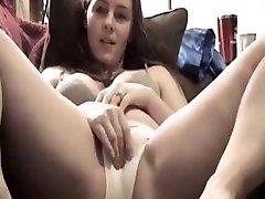Gorgeous girl likes degustating her own cum in her panties
