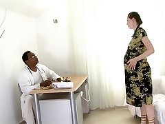 Heavily preggo brunette fucked by a black man