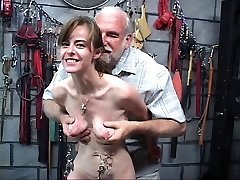 Skinny nymph with weights stringing up from her piercing