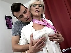 Insatiable granny with saggy tits fucked by a youthfull guy