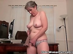 Elderly secretary Kelli strips off and fingers her furry pussy