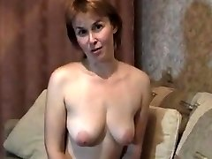Blond mature cougar at home stripteasing and fingering her pussy