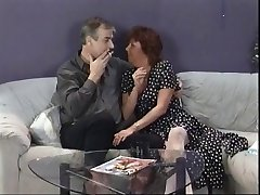 Mature brunette sucks husband's cock then eats young punk chick's cunny on couch