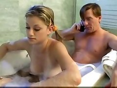 Parent and stepdaughter having fun in bathroom