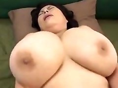 Japanese Mature with huge melons