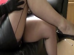 Breasty wifey in leather and nylons taunts cuck