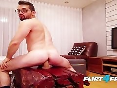 Hairy Stud Sits on His Thick Fake Penis and Fires Off a Thick Load