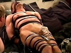 Extreme vacuum pumping CBT on leather bound and held muscle guy.