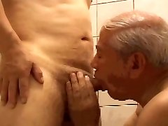 2  elderly men playing