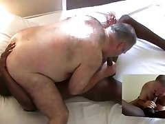 Ebony guy pummels big hairy bear