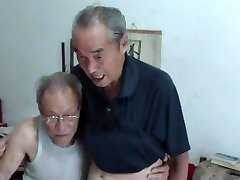 Asian old folks comparing cocks