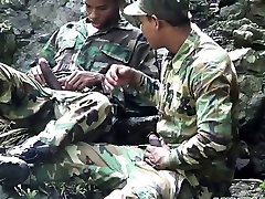 Army dudes scout for stiff meat outdoors