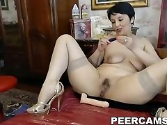 Busty mature honey toying both her holes on cam