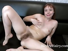 Trixie strips and masturbates on her ebony bed