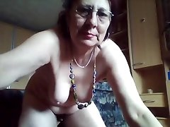 Kinky hairy grandmother enjoys peeing in the bucket