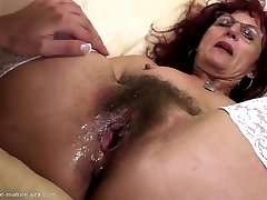 Deep handballing for beautiful mature mom's hairy pussy