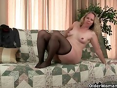 Mom's pantyhosed pussy gets her all hot and horny