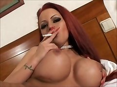 Mind-blowing ginormous tit smoking redhead masturbating