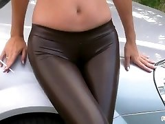 Smoking in Latex stretch pants with Cameltoe