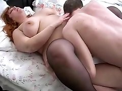 ginger-haired bbw mom and her son on couch