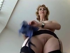 Mature English platinum-blonde babe in stockings upskirt taunt