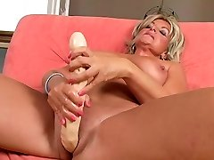 Kinky blonde granny is getting her twat poked with big dildo
