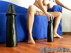 Mature woman lines up some hefty dildos