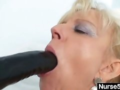 Old light-haired milf stuffing pussy with huge fake penis