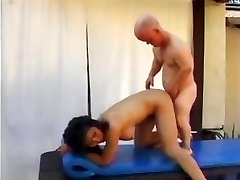 Mature Asian fuckslut Rosy Rocket has some fun by the pool with a midgets pipe and toys his ass