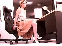 Mature leggy light-haired spreads her pretty muff at work
