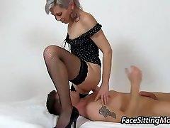 Hot pantyhose gams mom Beate sitting on a boy
