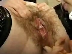 Hairy Lesbian mature going knuckle deep