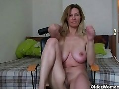 MILF with big boobs gropes her mature pussy